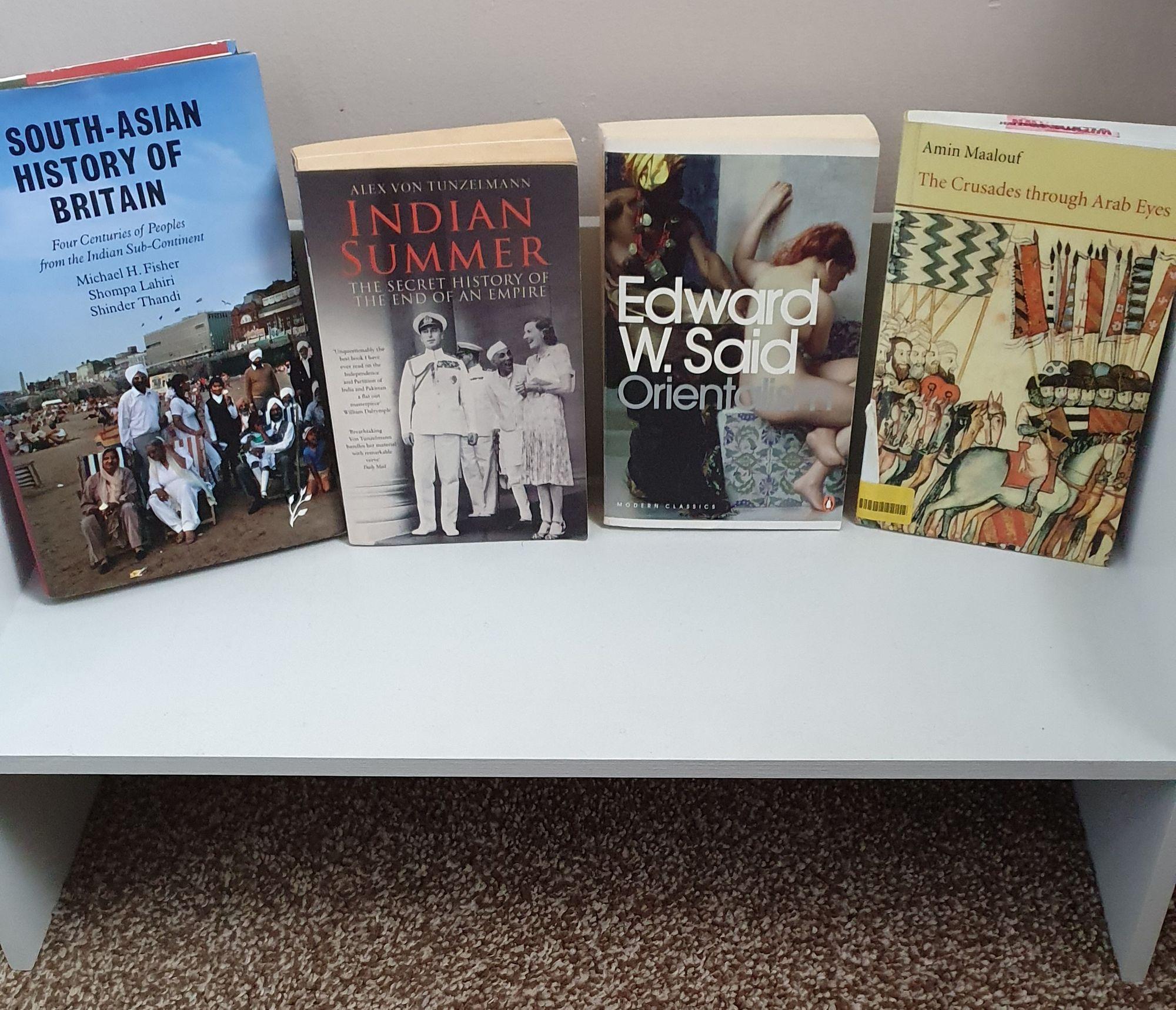 Selection of non-ficton books on a freestanding shelf