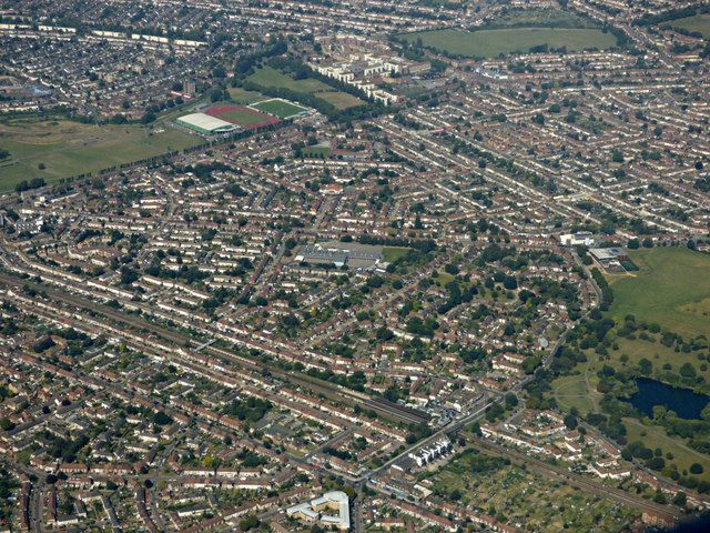 An aerial view of streets, buildings and fields, in a neat arrangement of rows and cul-de-sacs