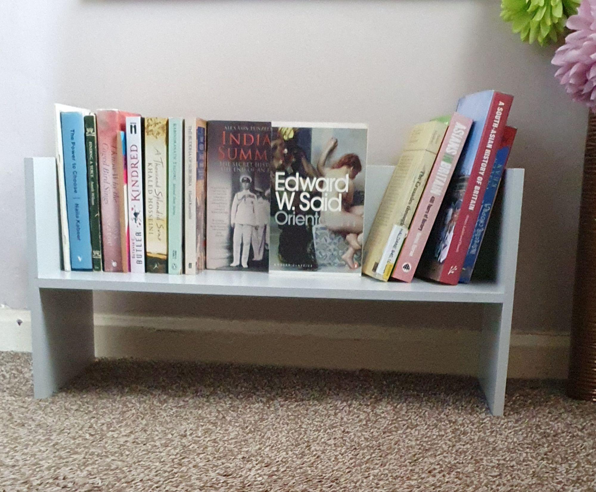 A free standing shelf of books