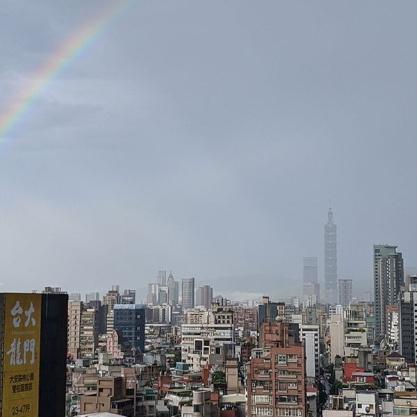 Photo of a rainbow over Taipei 101.