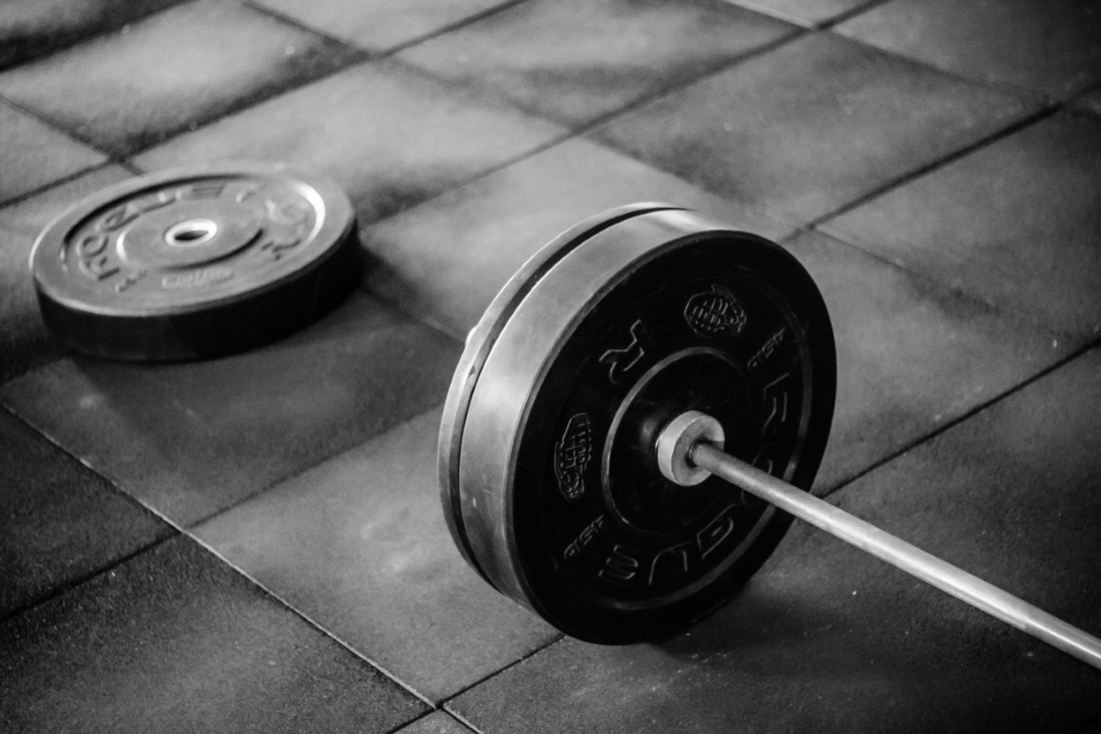 Weights in on the floor in a gym.