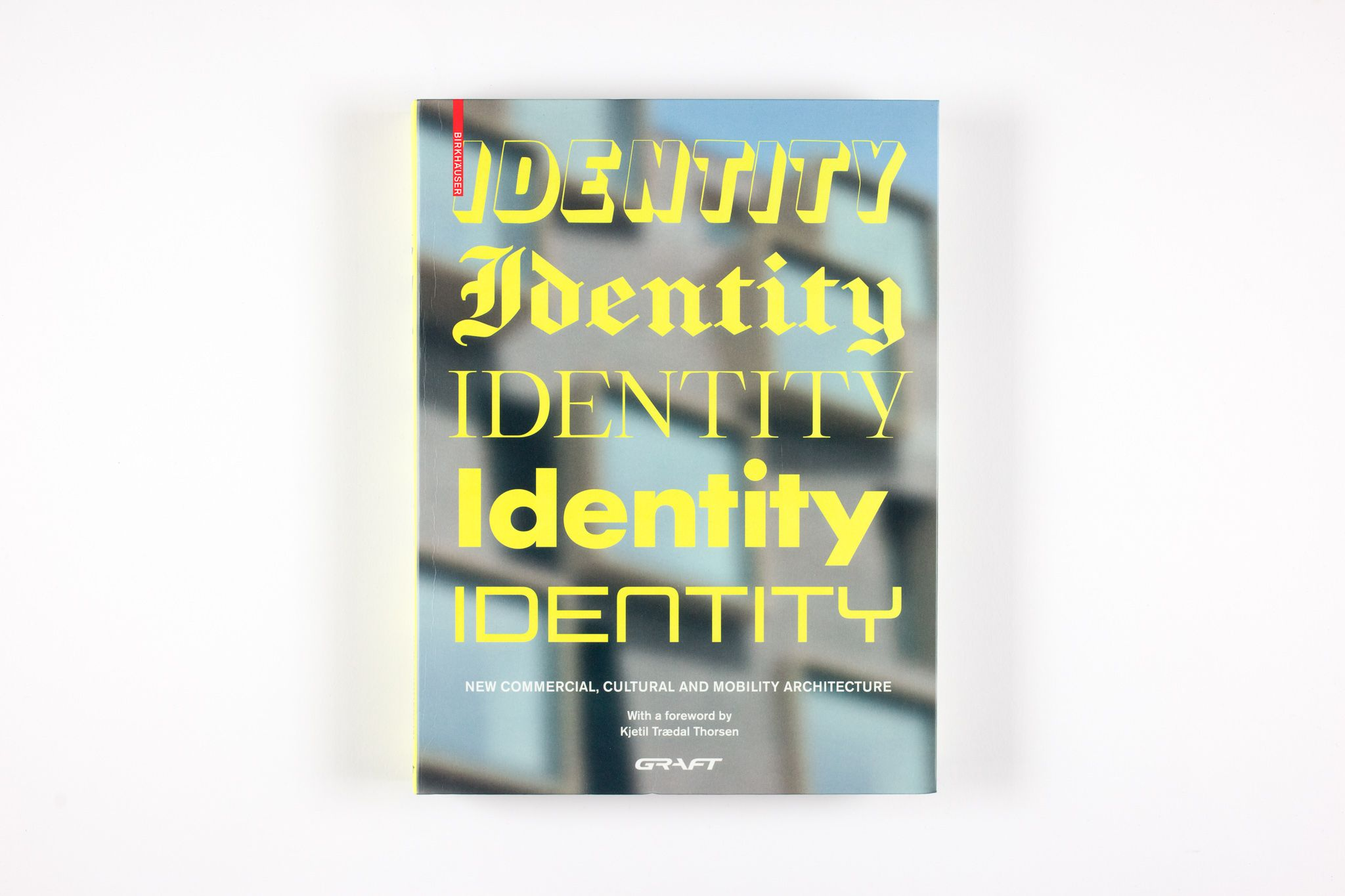 "IDENTITY. New Commercial, Cultural and Mobility Architecture Author		GRAFT Project type	Publication Language	English Publisher	Birkhäuser  Paperback	360 pages Published	October 12, 2020  ISBN-10	3035619166 ISBN-13	978-3035619164   The international and multidisciplinary practice GRAFT conceives of itself as a label for architecture, urban design, product design, and music. GRAFT calls itself a ""hybrid office"" and produces dynamic architectural designs for standard commissions; however, the architects also initiate their own projects and system solutions for tasks with a social, ecological, or esthetic emphasis."