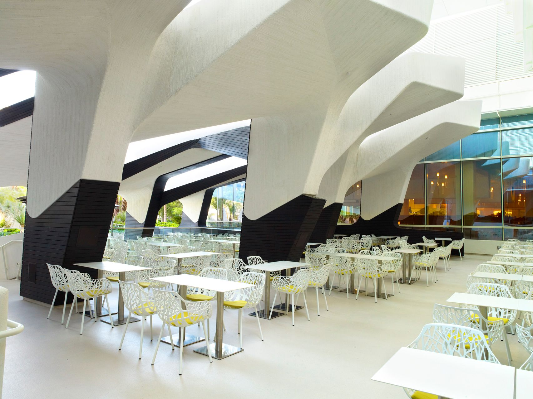 CITY CENTER Project type: Hospitality, Bar, Club     Location: Las Vegas, U.S.A.     Time: 2010     Client: MGM Mirage     Status: Completed     Size: 17,000 sqm     Photos: Ricky Ridecos  City Center's Aria Pool Deck, Restaurant and Bar, Las Vegas