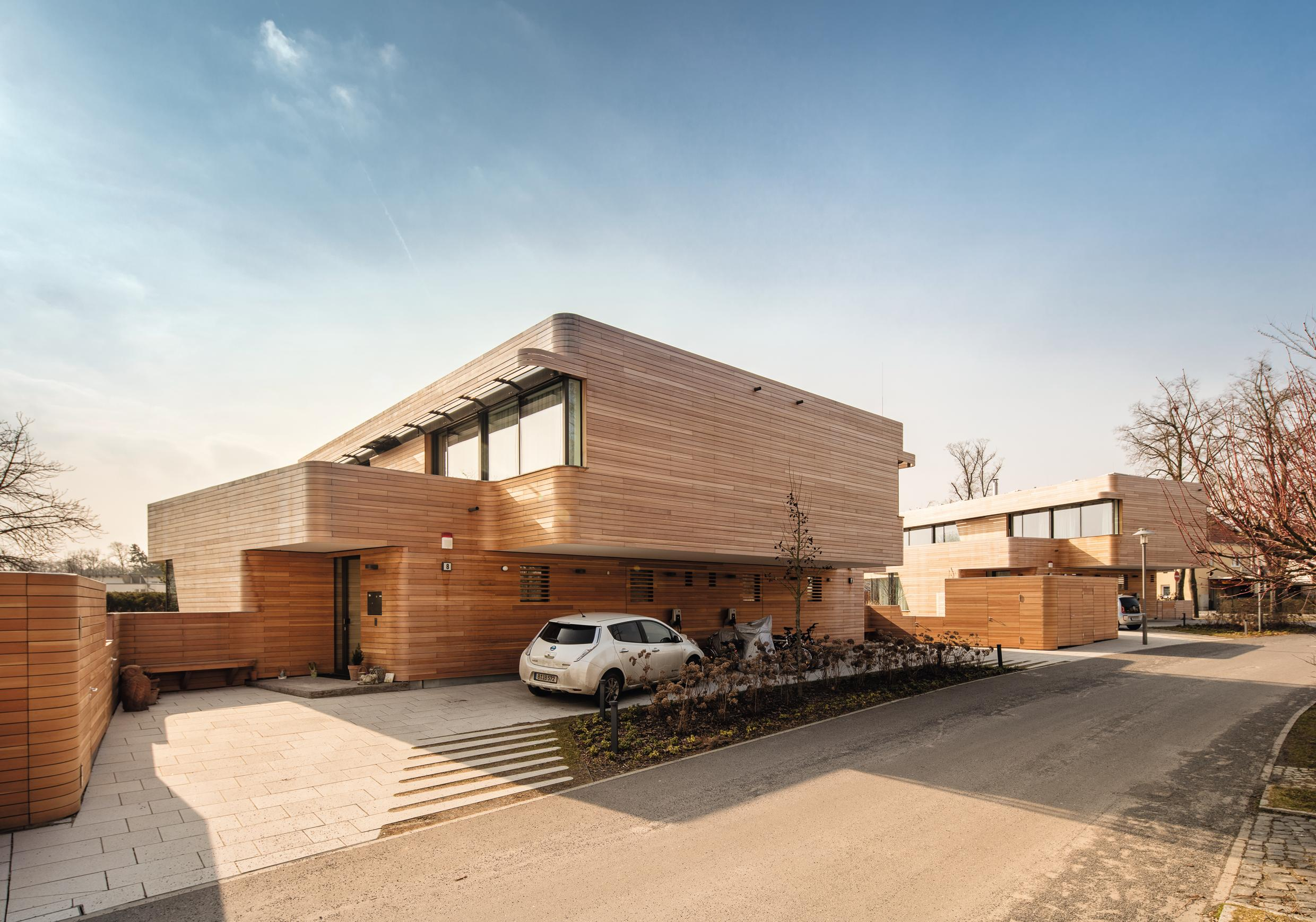 Holistic living: GRAFT designed three plus-energy houses made of sustainable and healthy materials that are completely re-usable and recyclable. The houses generate their own energy and the surplus is used to power an electric vehicle integrated into the technical systems of the house.