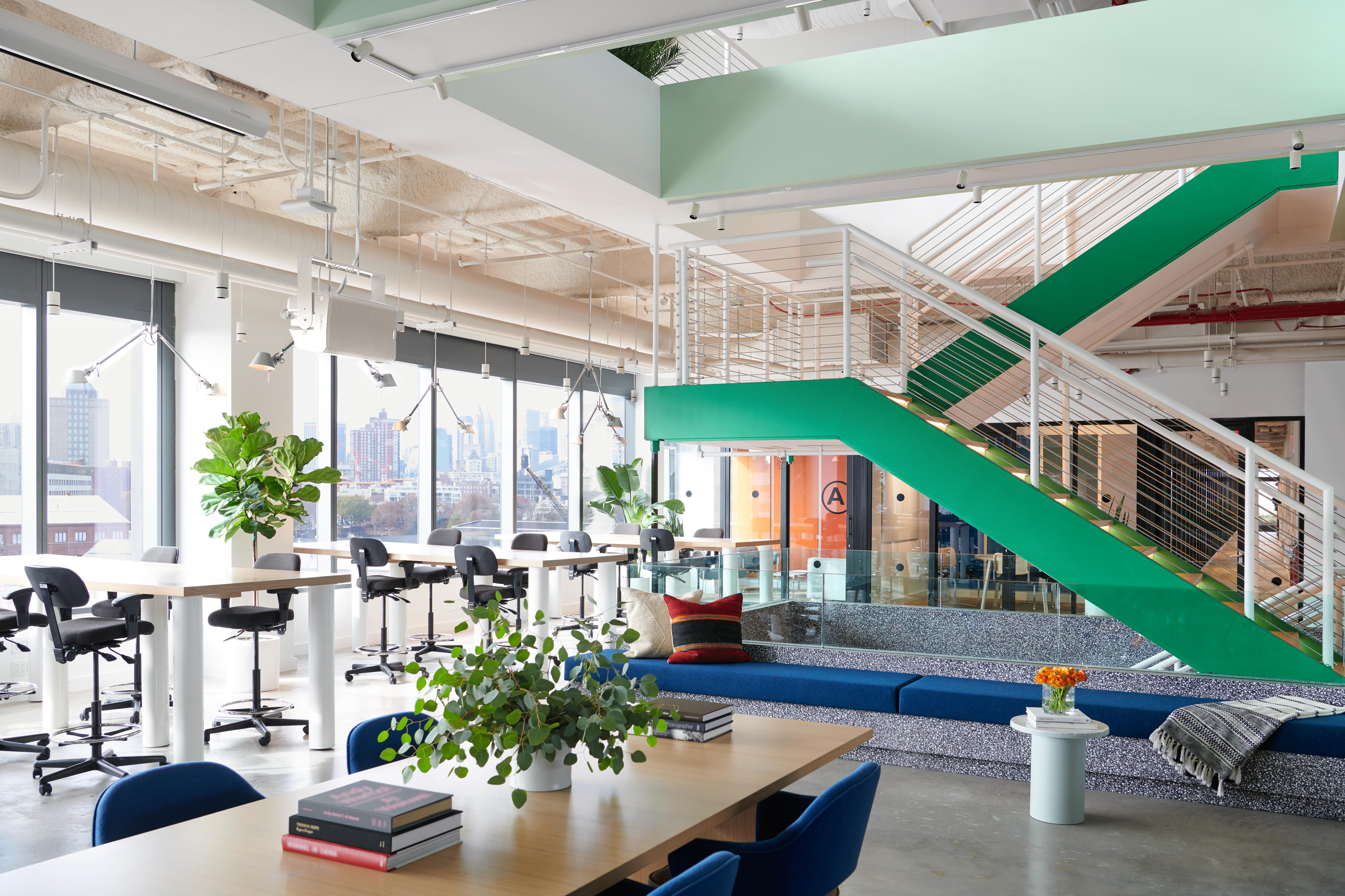 Common areas at WeWork blend work and leisure zones to provide diverse workspaces