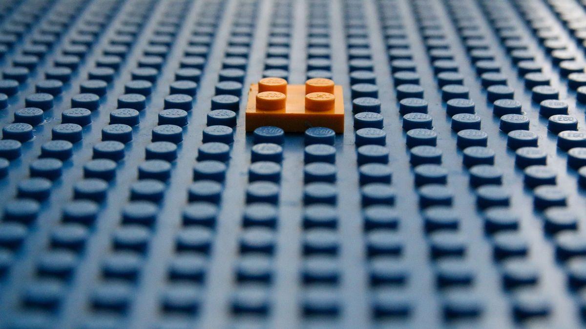 Orange block on a blue block base