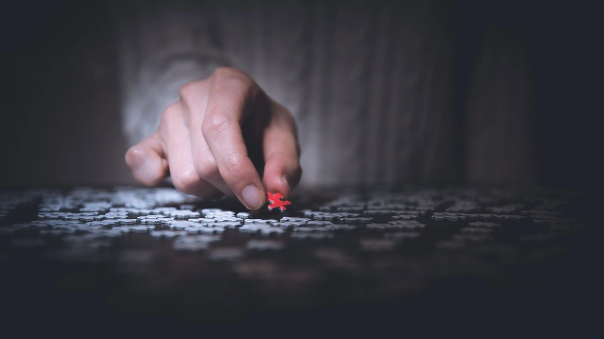 image of a man place a puzzle piece