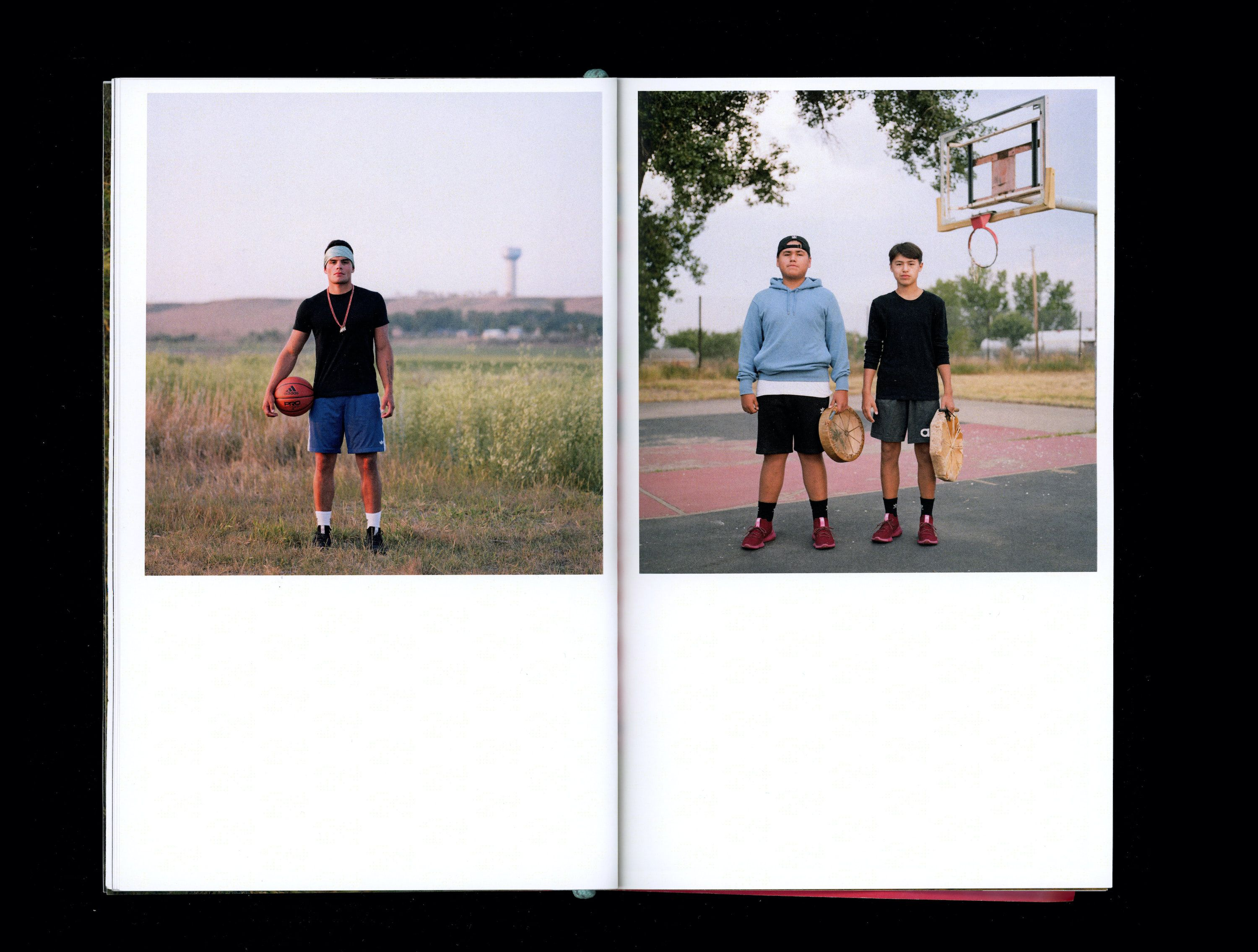 Photograph in book of Joe Jahner, Lance & George Bradley holding basketball in front of basketball pitch