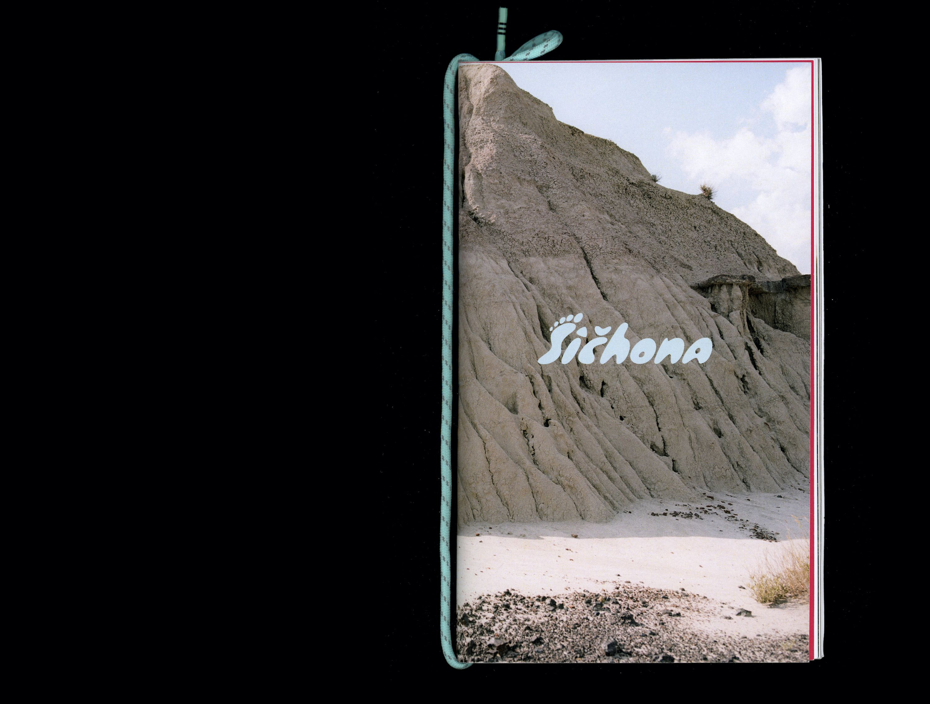 Book cover with photo of mountainous rock in sandy desert