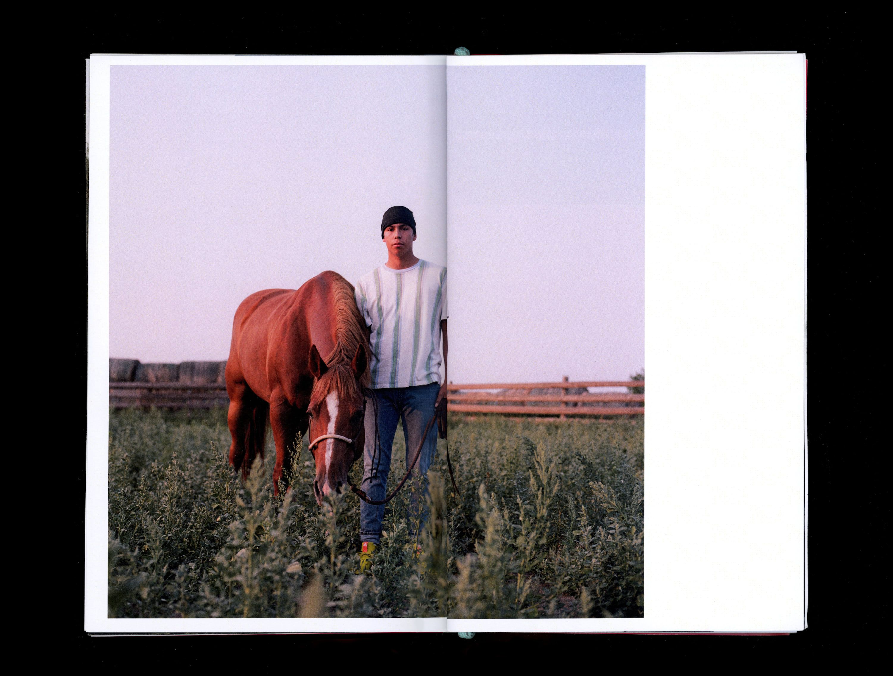 Photograph in book of Maize Two Bears standing in field with horse