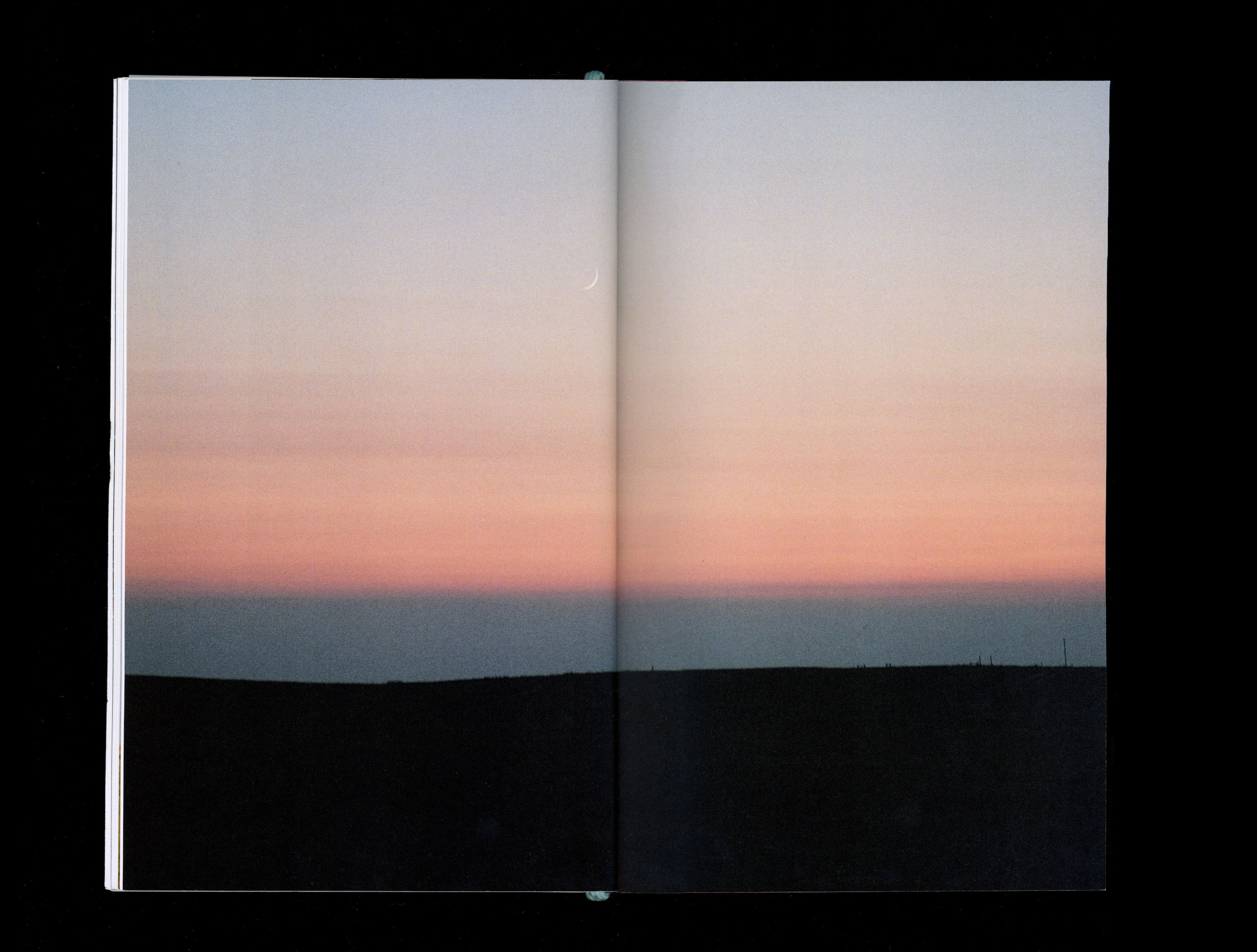 Photograph in book of blue and pink sunset