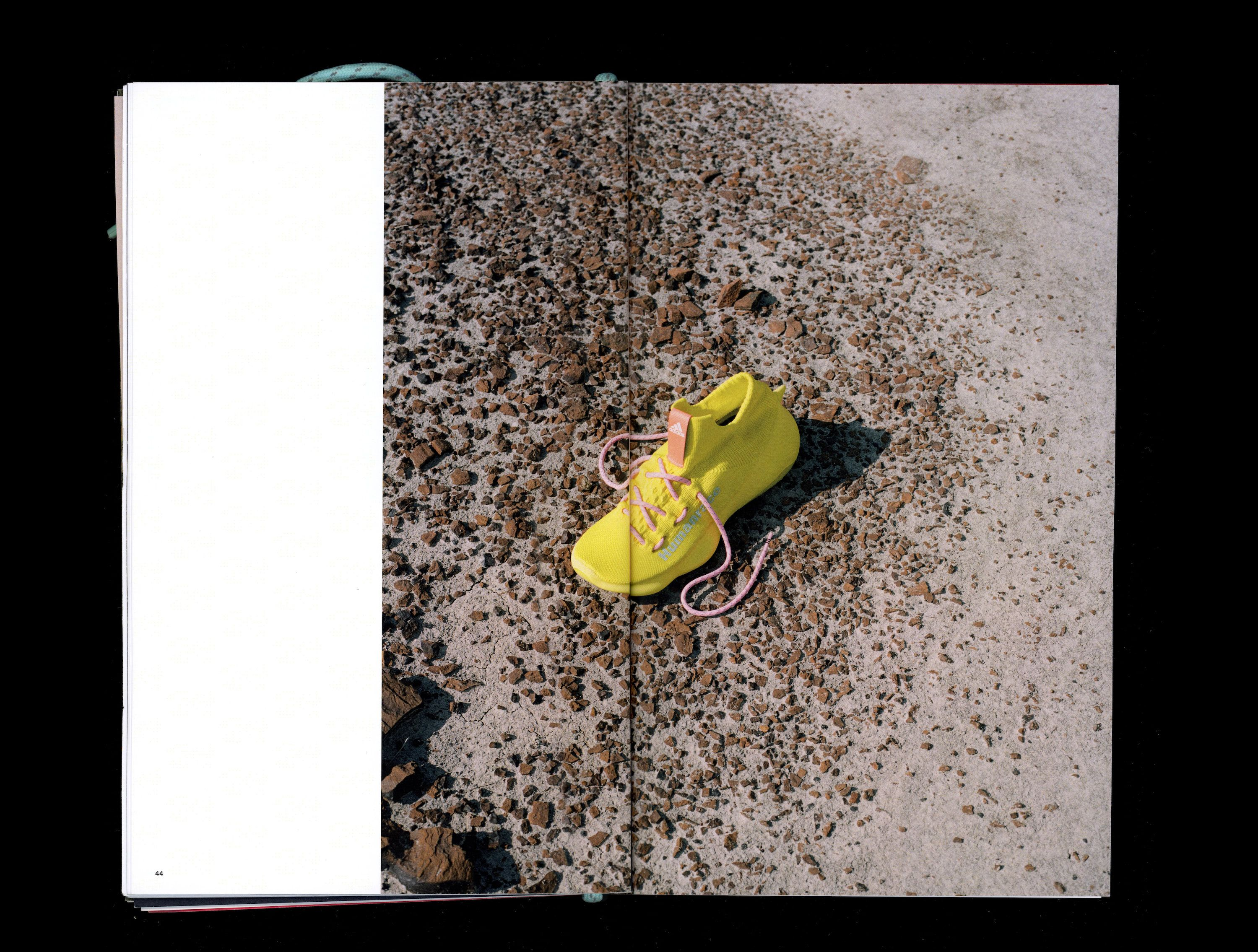 Photograph in book of yellow Sičhona shoe on rocky ground