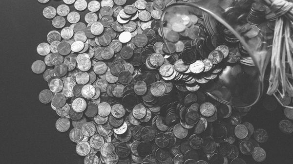 Coins falling from a piggy bank