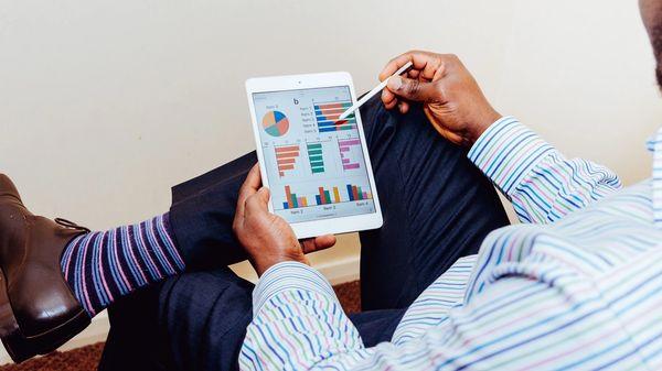 An investor examining his portfolio performance.