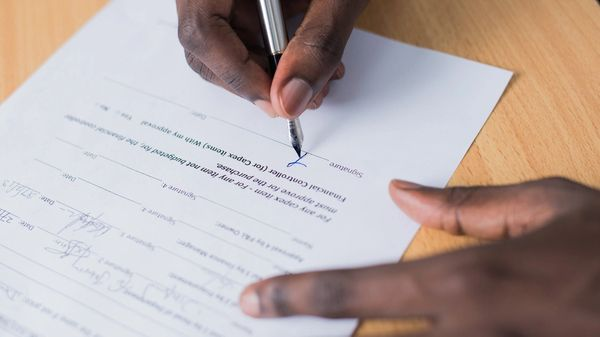A financial professional filling out paperwork