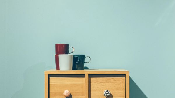 Wooden dresser with cups