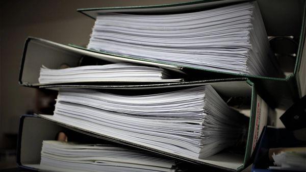 A closed binder full of legal paperwork