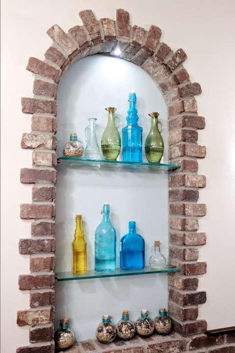 Troika Restaurant display nook with bottles
