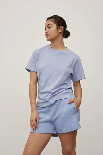 Model wearing the Track Shorts with the Classic T-shirt in Powder Blue.