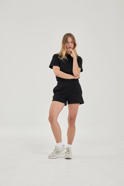 Model wearing the Track Shorts Black with the Classic T-shirt Black.