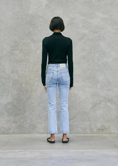 Model wearing the Slim Fit Jeans Blue with the 01 Turtleneck Black.
