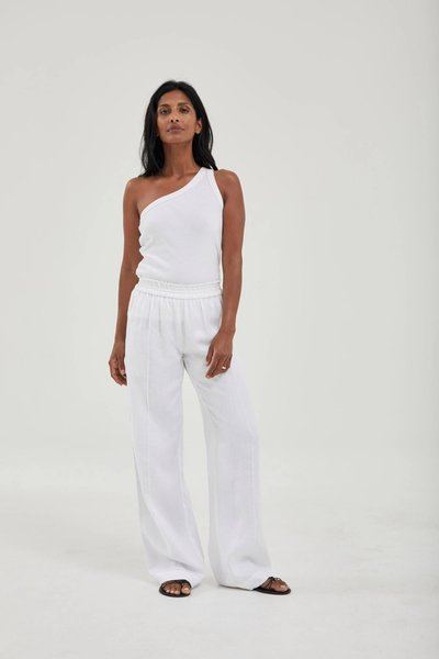 Model wearing the Linen Pants White with the One Shoulder Singlet White.