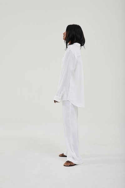 Model wearing the Linen Pants White with the Linen Shirt White and One Shoulder Singlet White.