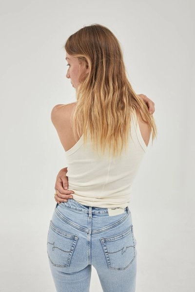 Back shot of model wearing the Slim Fit Jeans Blue with the 01 Singlet Bone.