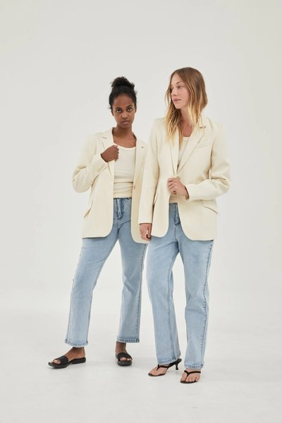 Two models wearing the Slim Fit Jeans Blue with the 01 Blazer Ivory.