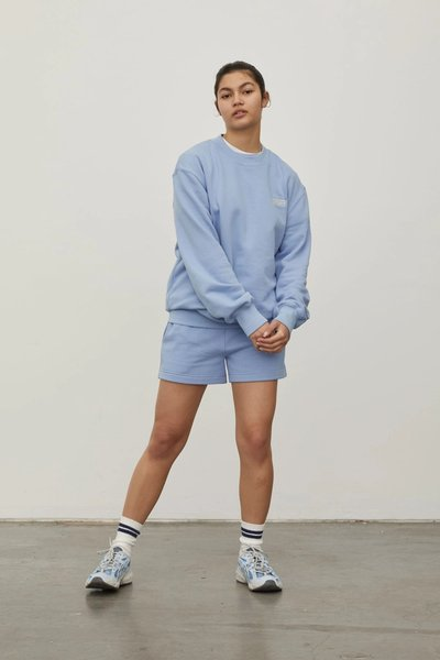 Model wearing the Track Shorts with the Crew Neck Sweatshirt in Powder Blue.