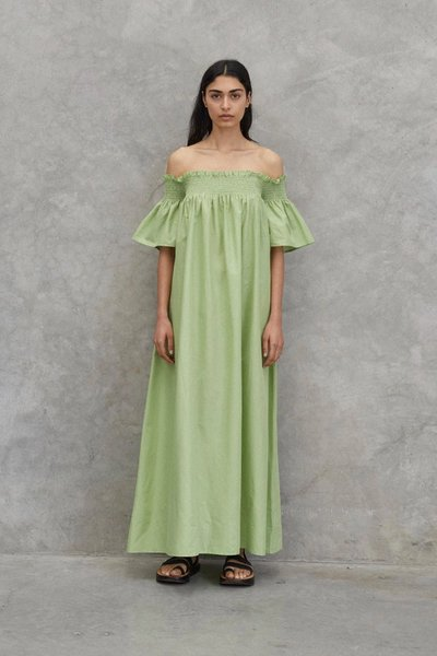 Model wearing the Tend to your Soul Dress in Avocado.