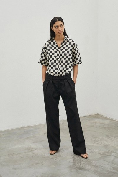 Model wearing the See You At Coco's Cantina Shirt in Ivory Black Check and the Bobbi Boyfriend Pant Black.