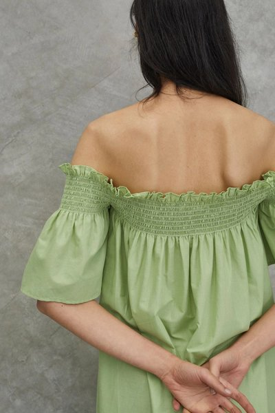 Back shot of model wearing the Tend to your Soul Dress in Avocado.