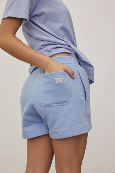 Close up of model wearing the Track Shorts in Powder Blue from the back.