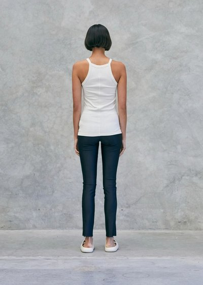 Model wearing the 01 Leggings Black with the 01 Singlet White. Turned around to show the back.
