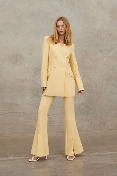 Model wearing the Dreamer Pant 2.0 with the Talk of the Town Blazer Dress in Custard.