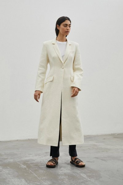 Model wearing the Sprinkling of Strength Coat Ivory with the 01 Leggings Ivory.