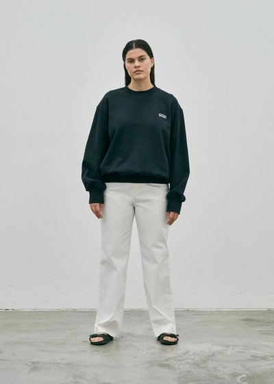 Model wearing the Crew Neck Sweatshirt Black with the 01 Jeans Ivory.