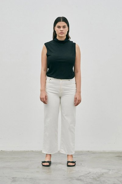 Model wearing the 01 Turtleneck Singlet Black with the 01 Jeans Ivory.