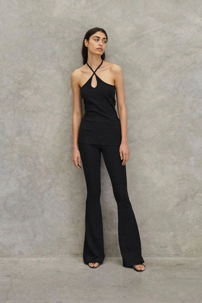 Back shot of model wearing the Lead with Love Trousers with the Key To My Heart Top in Black.