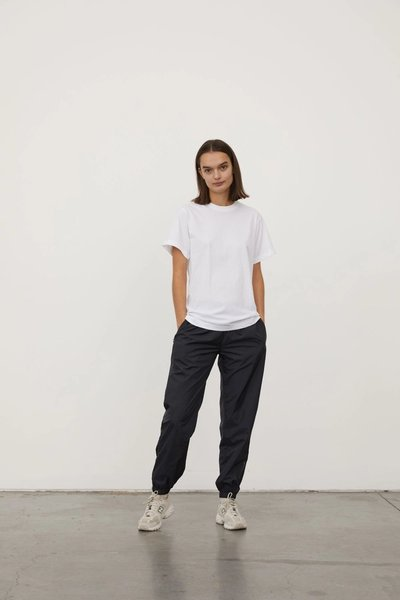 Model wearing the Spray Track Pant with the Classic T-shirt White.