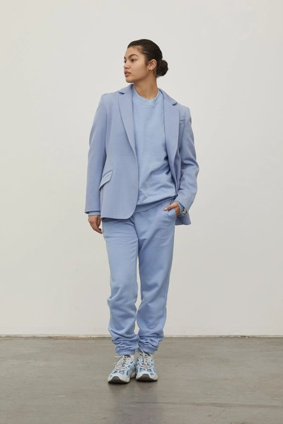 Model wearing the Track Pants in Powder Blue with the 01 Blazer.