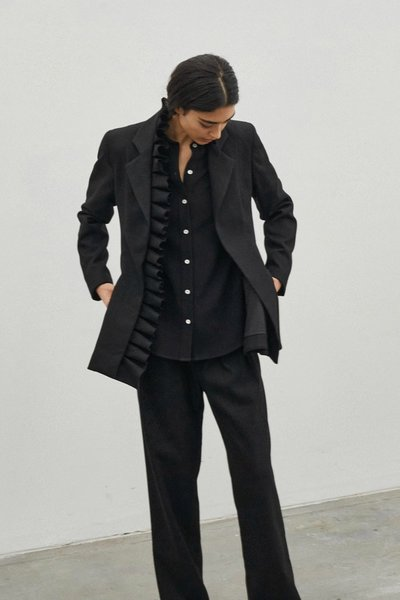 Model wearing the I Lead From the Heart Blazer with the Bobbi Boyfriend Pants in Black.