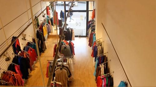 view from the ceiling of a custom clothing shop for women, wooden floor