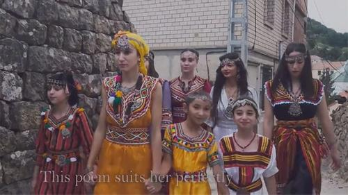 4 women and 4 girls, holding hands, dressed in traditional Algerian garb