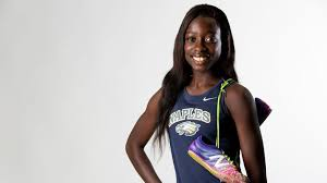 portrait of woman track star wearing Nike shirt and shoes, bearing the name Naples, Florida, tee shirt