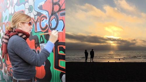 artists painting a mural on an exterior wall, looking at a sunset