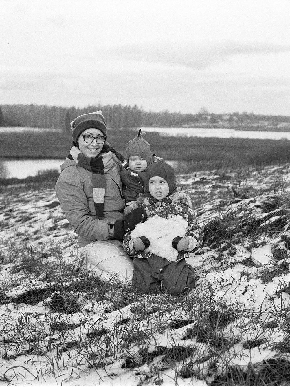 Photo of a family in snow.