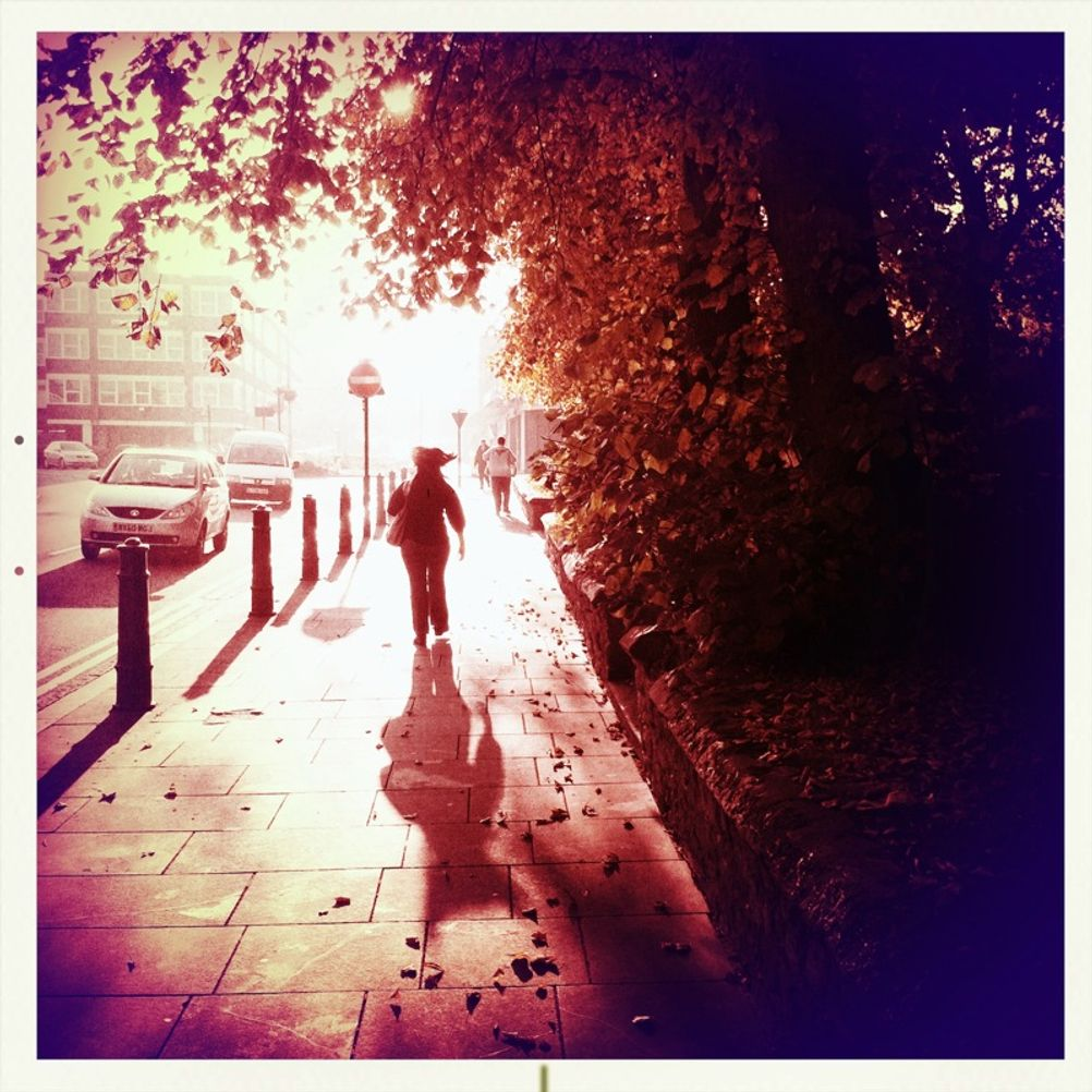 Photo of a woman walking on the street.