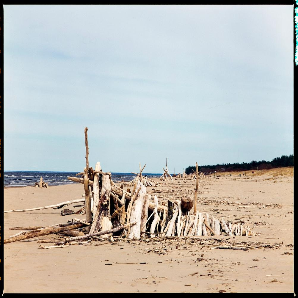 Photo of wooden structures on the beach.